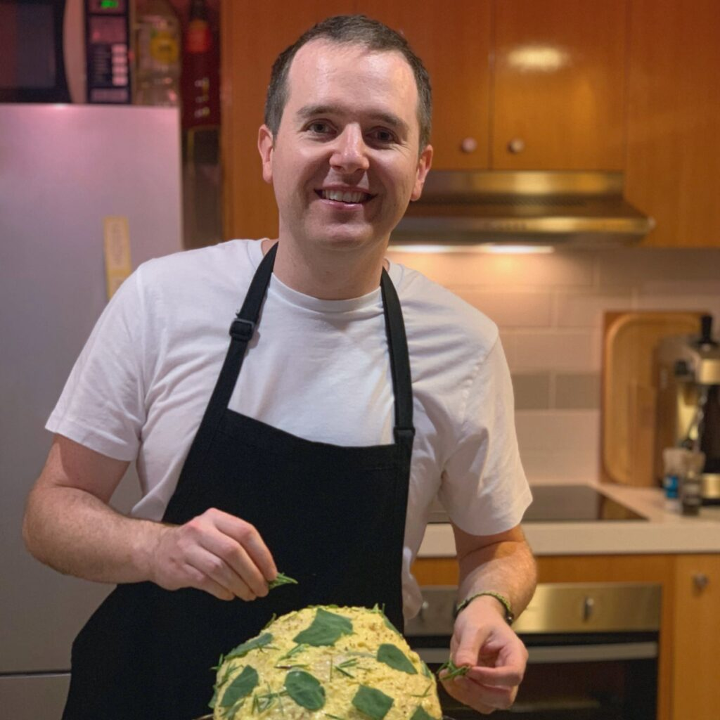 James, the author of Southside Kitchen, placing rosemary on a turkey that is coated in butter in preparation for roasting