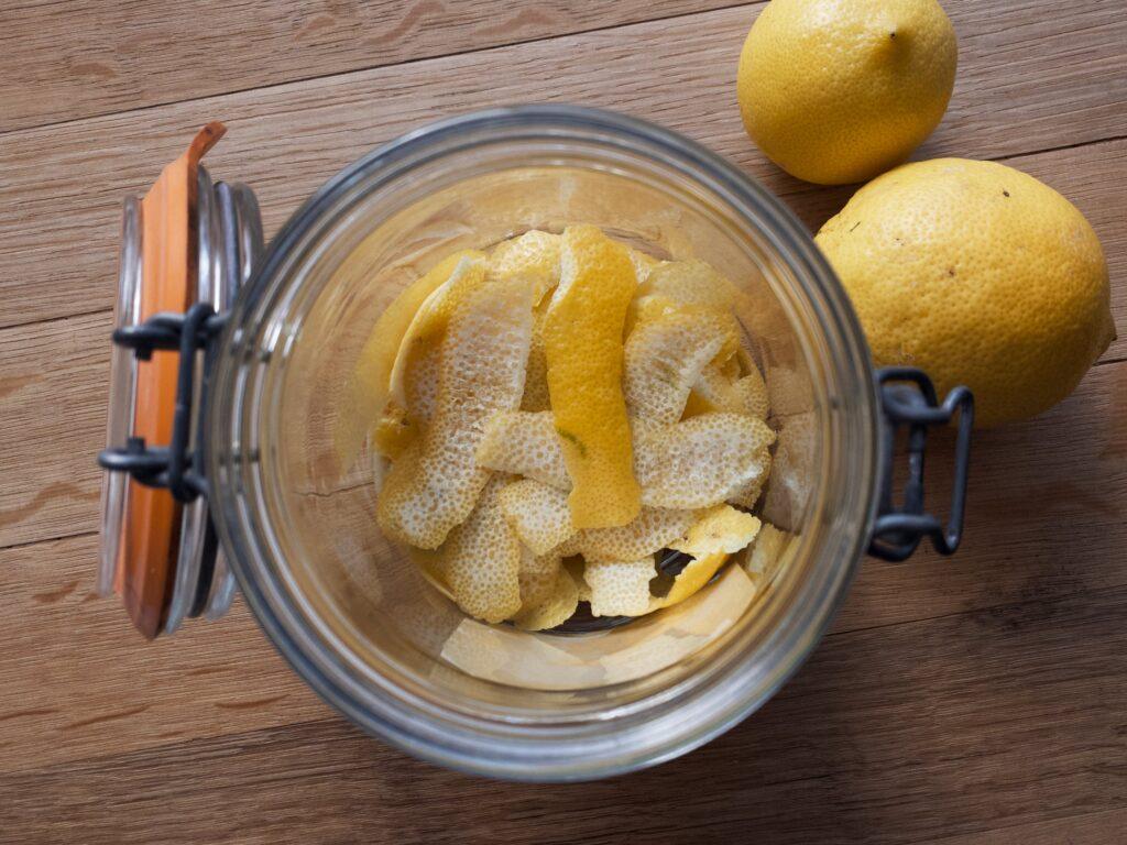 Lemon peel sitting in bottom of mason jar