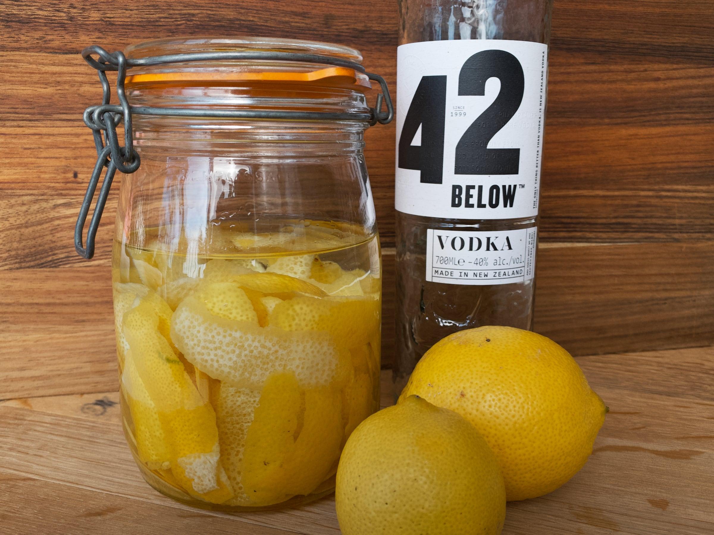 Sealed mason jar filled with lemon peel and vodka