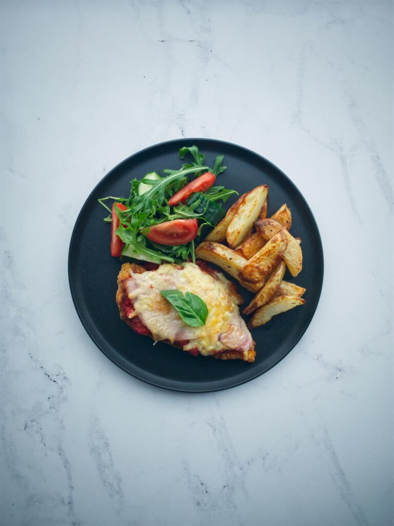 Chicken parmigiana with oven-baked chips