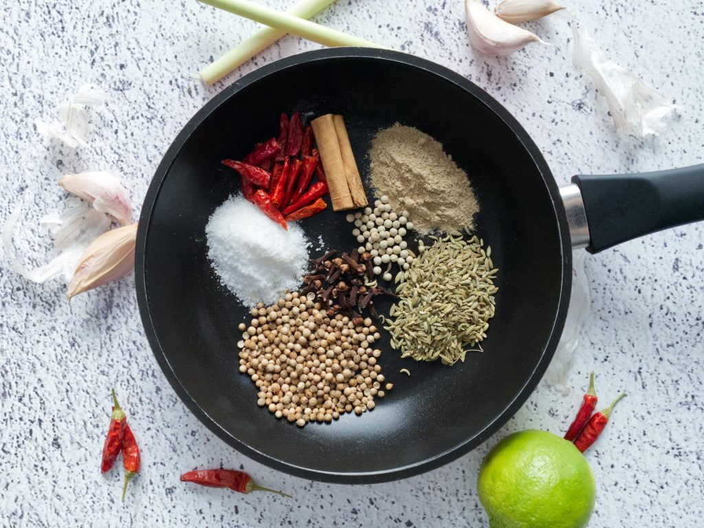 Frying pan with all the dried ingredients laid out
