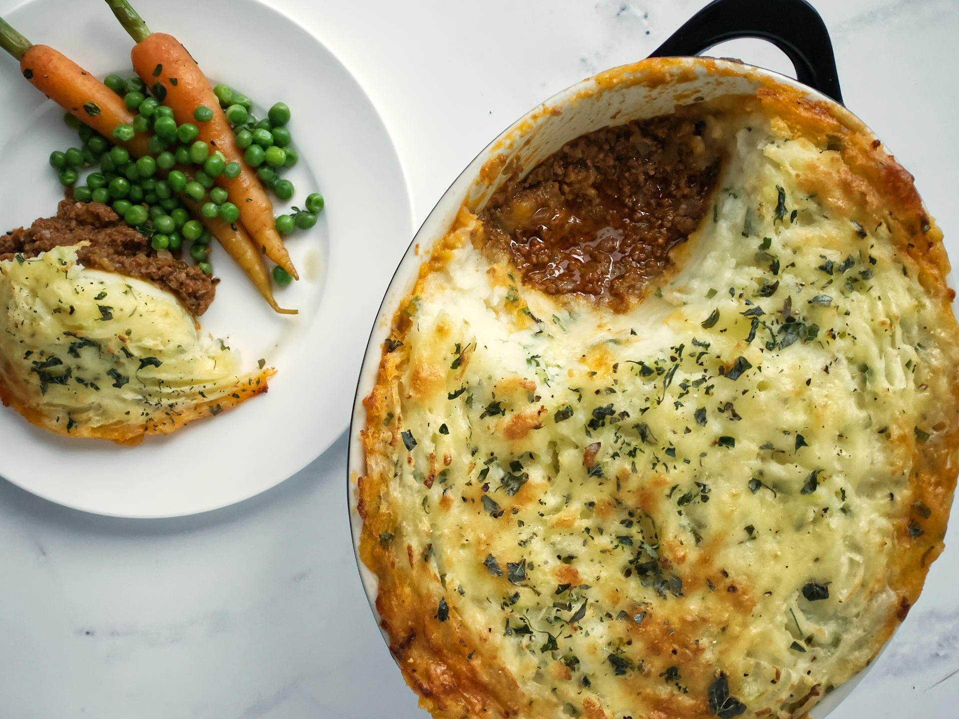 Shepherd's Pie served with Braised Peas and Carrots