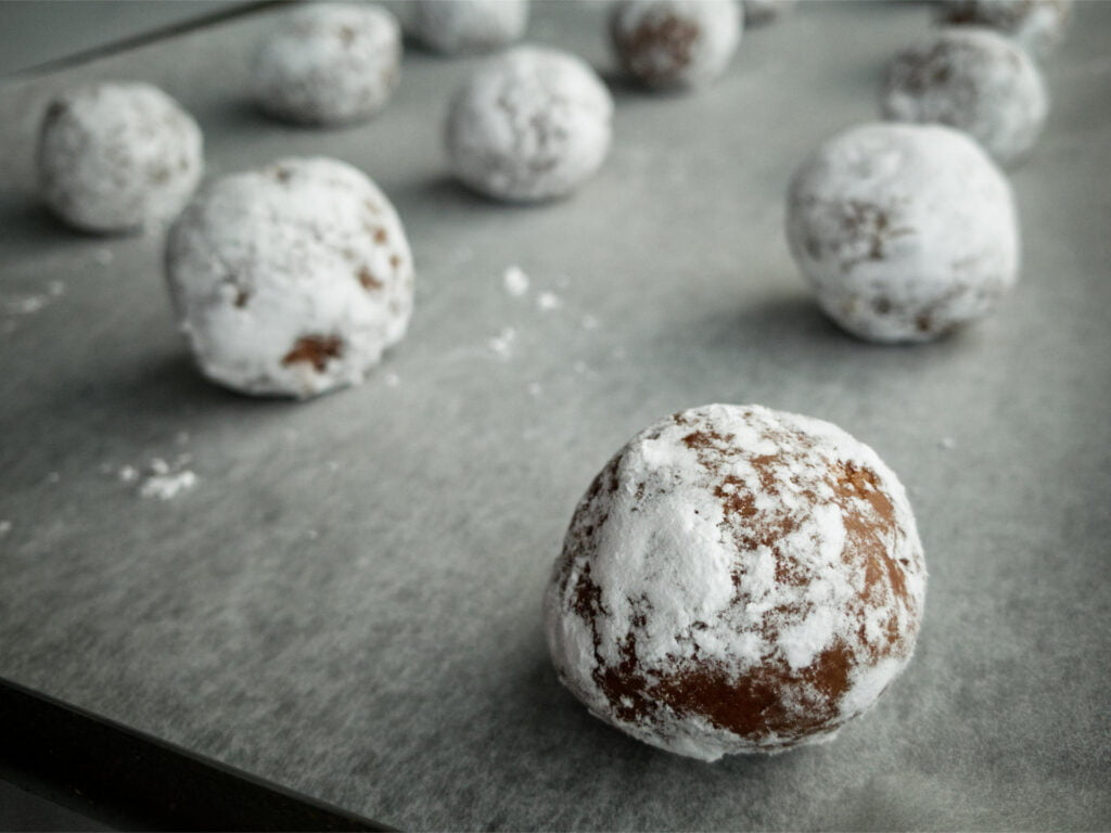Chocolate Crackle Cookie balls on baking tray