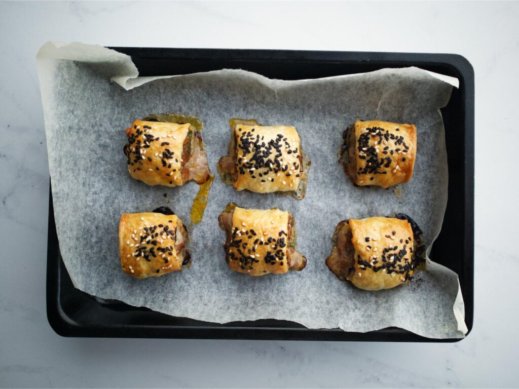 Beef sausage rolls in baking tray
