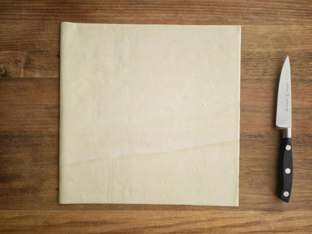 Puff pastry sheet laying on flat surface