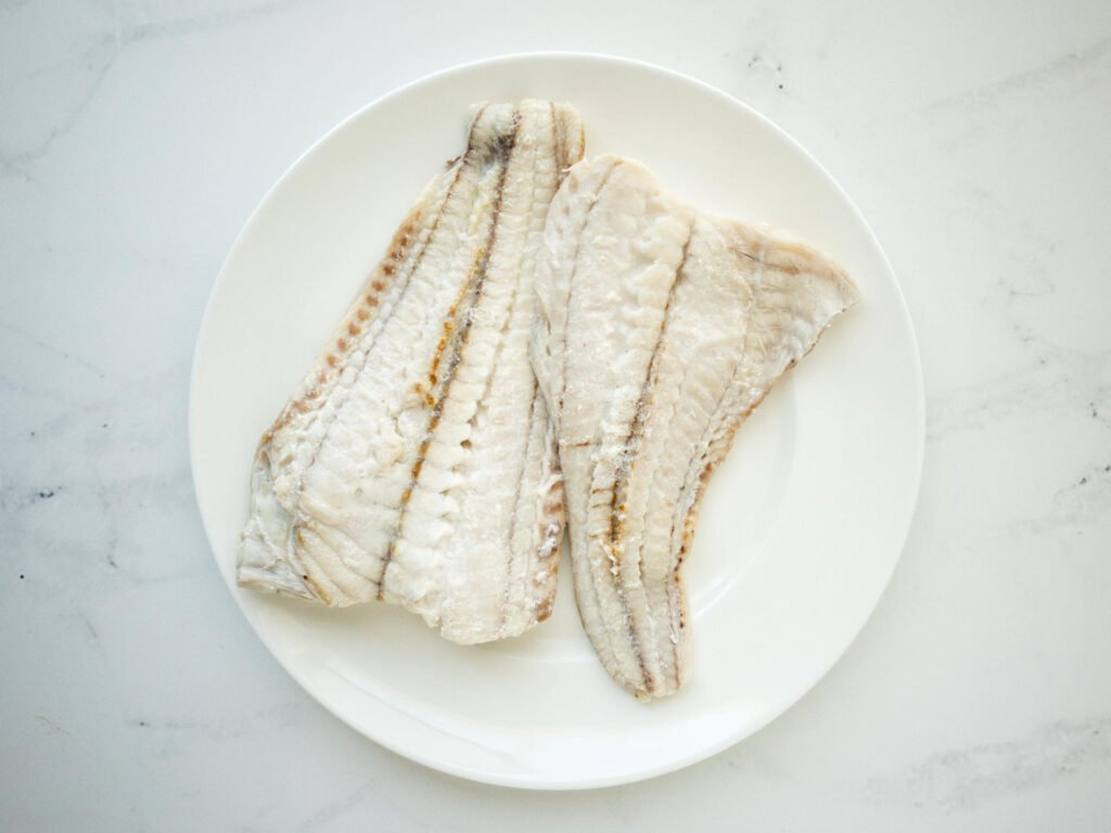 Cooked Rockling fillets on a plate