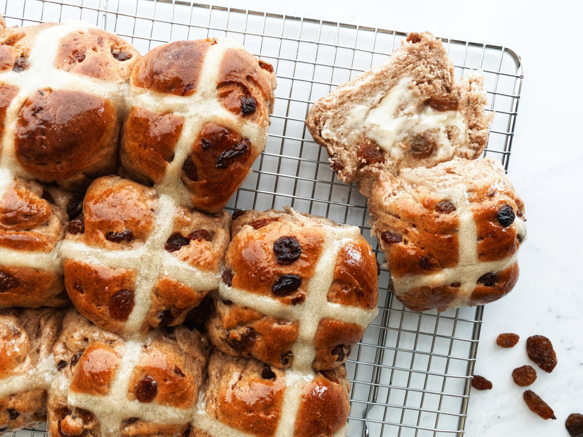Delicious hot cross buns with lashings of butter