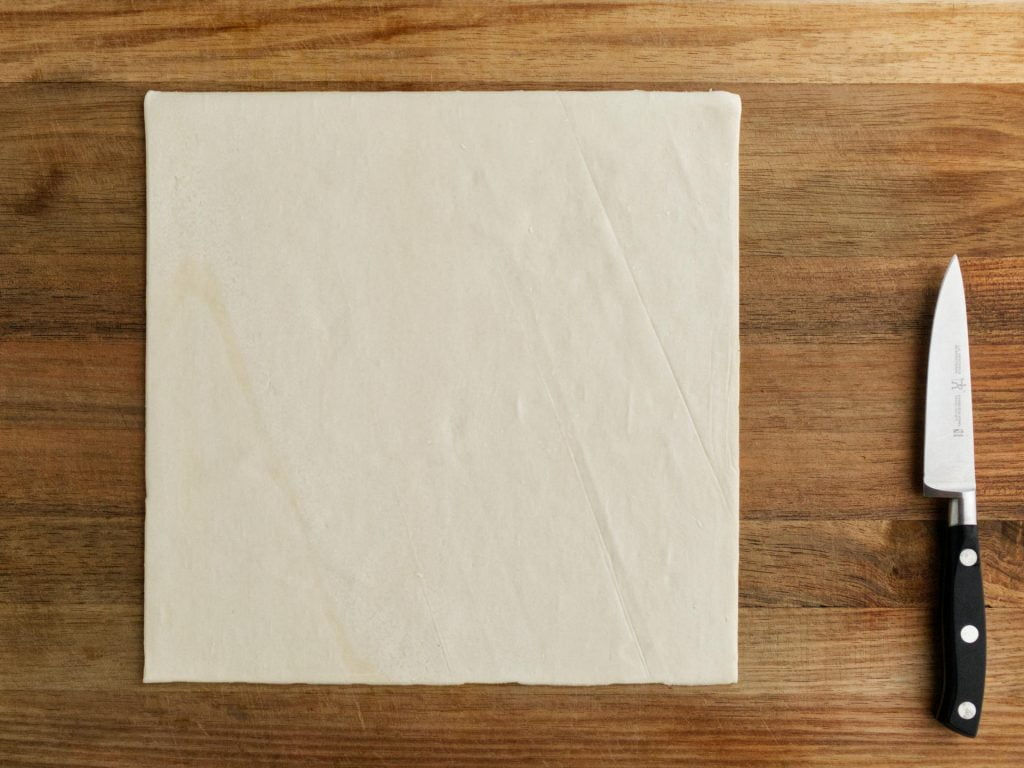 Sheet of puff pastry on cutting board